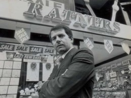 Photo of Gerald Ratner in front of a Ratners jewellery shop