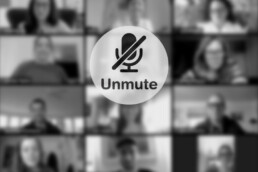 "• Image of a computer screen in a video conference showing the message ""unmute"""