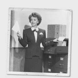 Vintage image of a woman filing documents in an office