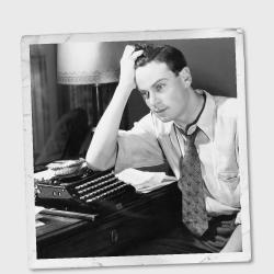 Vintage photo of a man at a typewriter