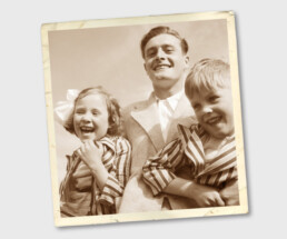 • Vintage image of happy family, father and two children.