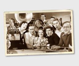 Vintage photo of a group of men and women with musical instruments