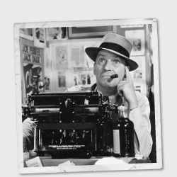 Vintage photo of man wearing a hat and using a typewriter