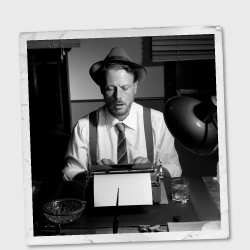 Vintage image of man wearing a hat and using a typewriter